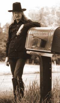 Richard Brautigan standing at his mailbox in Pine Creek